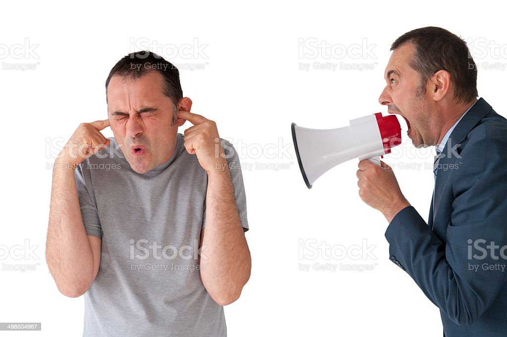 man being yelled at by manager stock photo