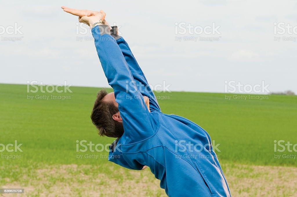 man bend backward profile stock photo