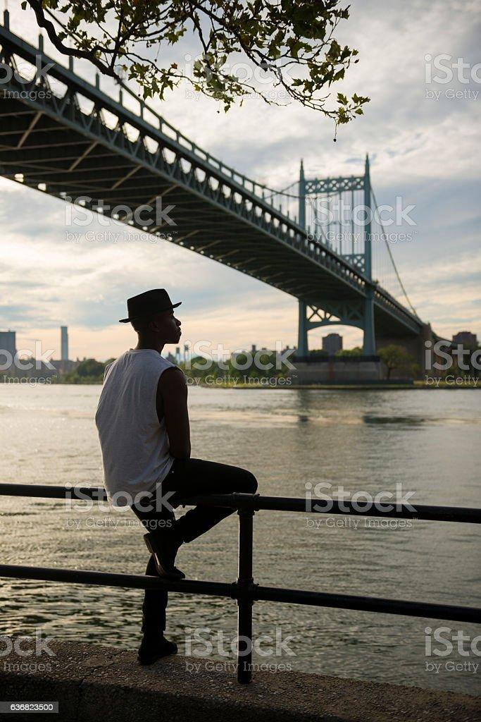 Man beside East River in Astoria, Queens, New York City stock photo