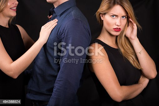 494388938istockphoto Man betraying his girlfriend 494388524