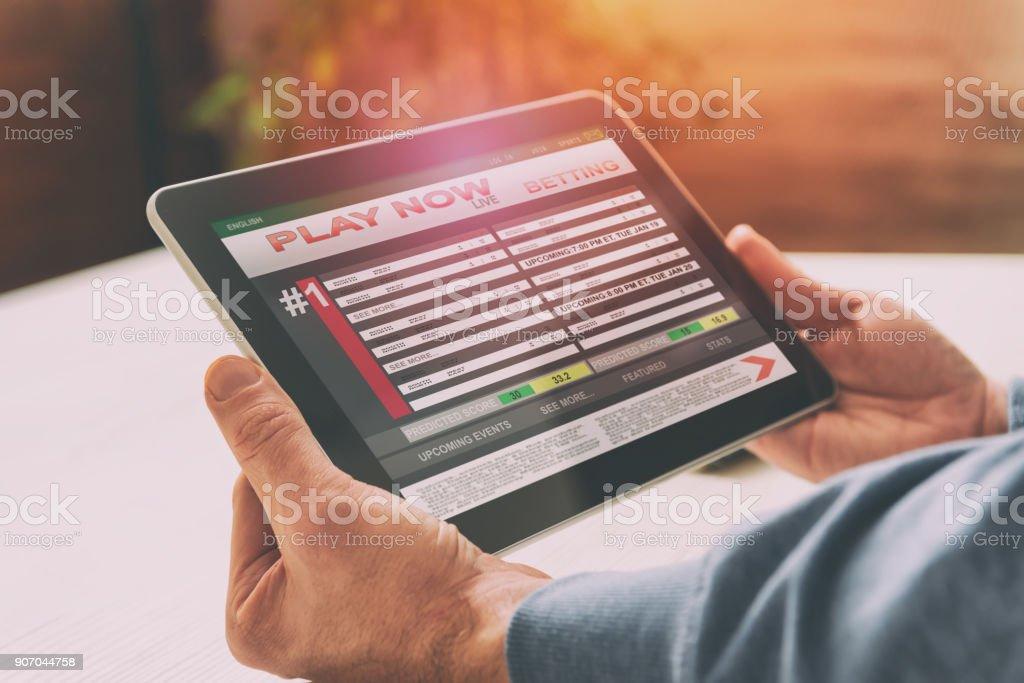 Man betting on sports stock photo