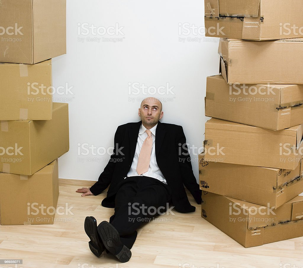Man between boxes royalty-free stock photo