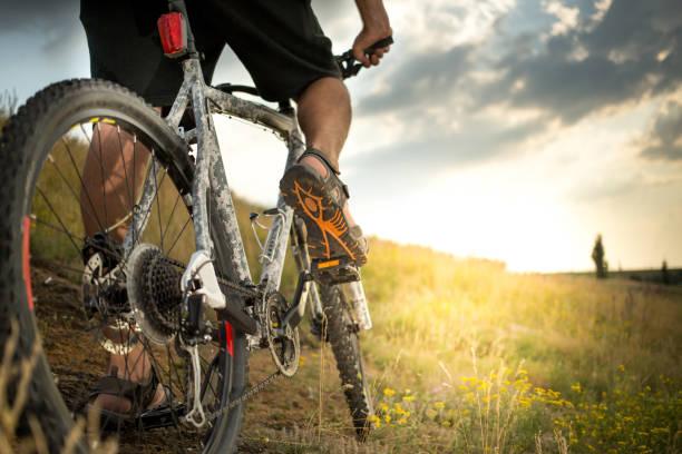 Man biking outdoors Man biking outdoors with beautiful evening light mountain biking stock pictures, royalty-free photos & images