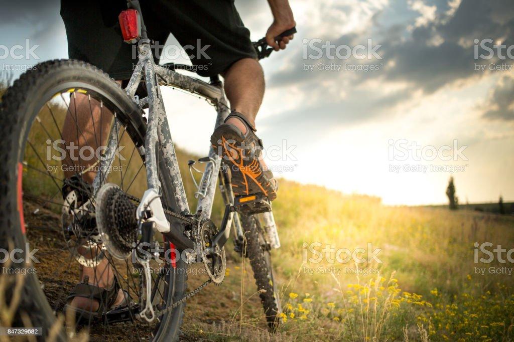 Man biking outdoors stock photo