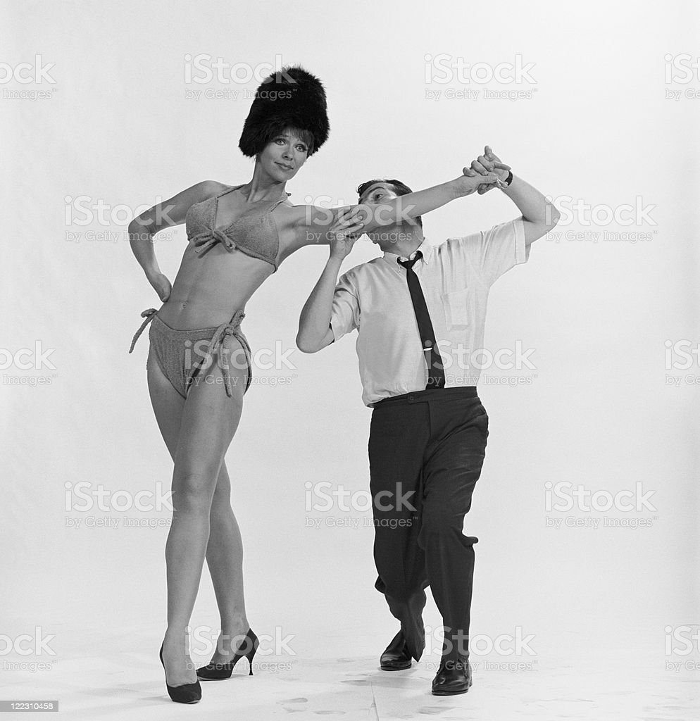 Man biting woman's arm stock photo