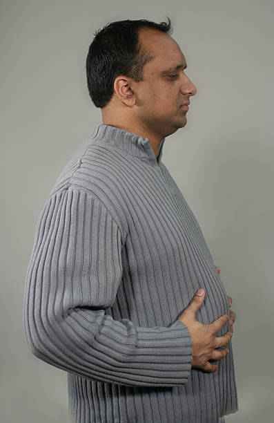 man bloated profile stock photo