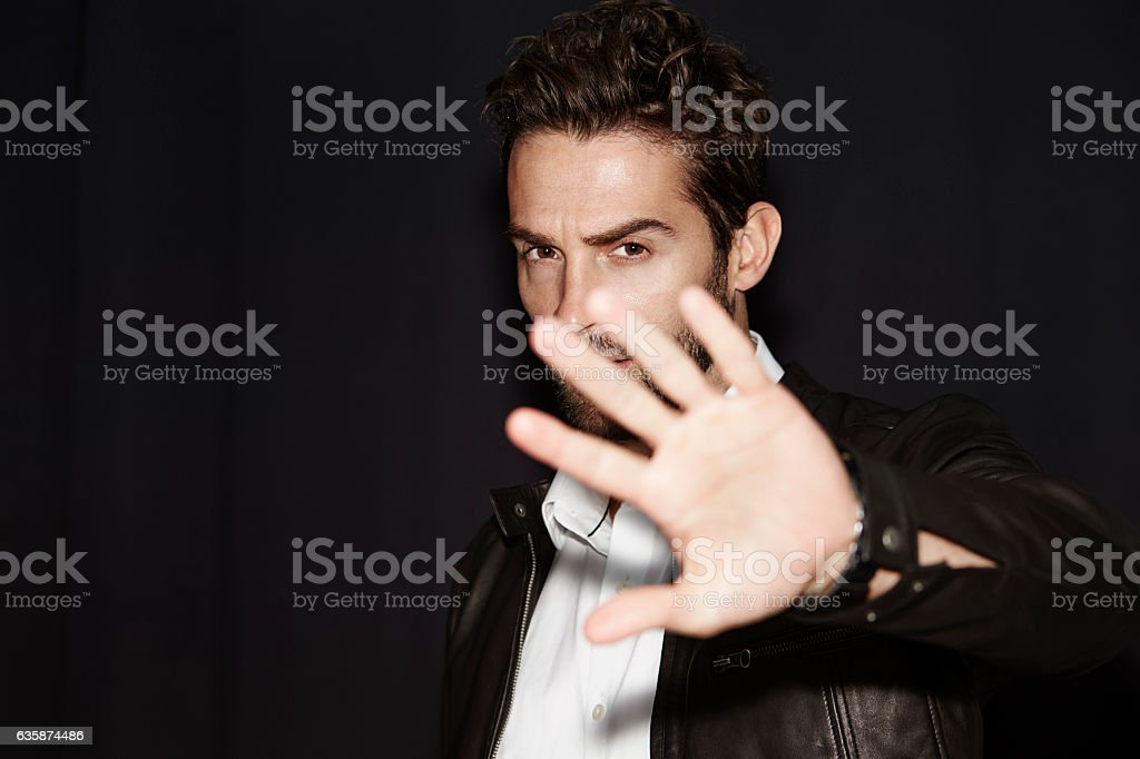 Man blocking photograph stock photo