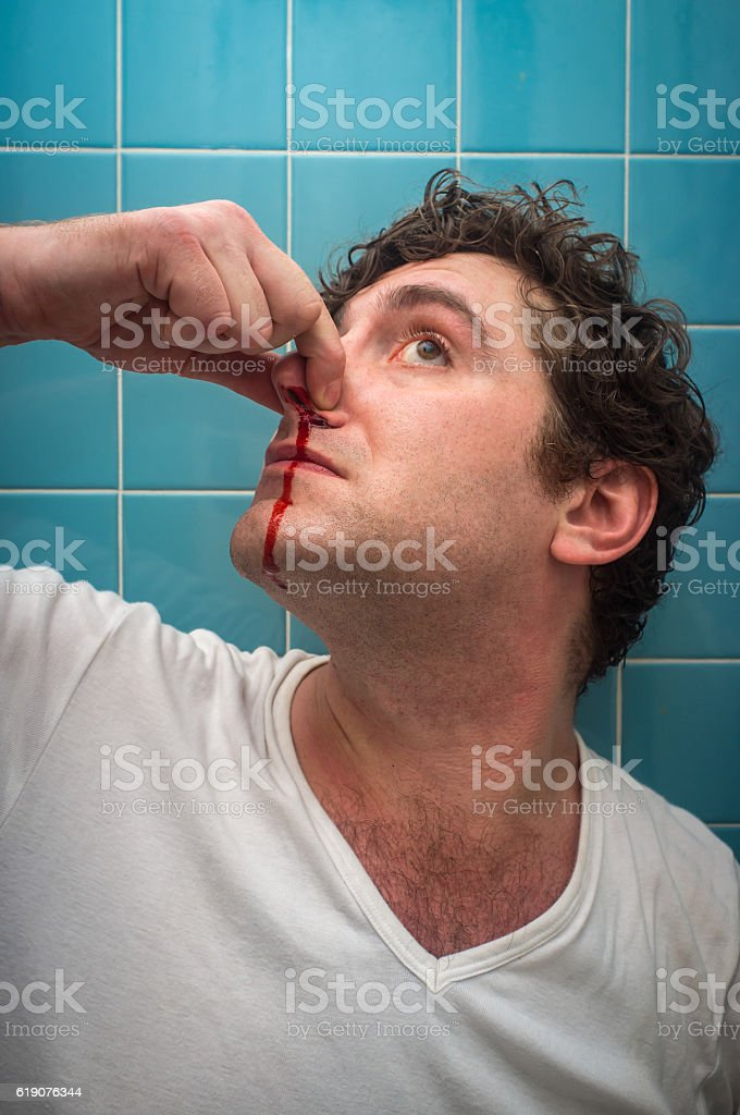 Man Bloody Nose stock photo