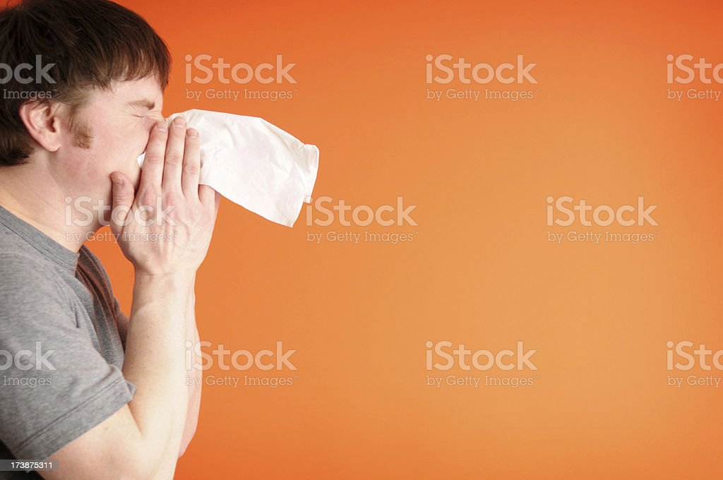 Man Blowing His Nose royalty-free stock photo