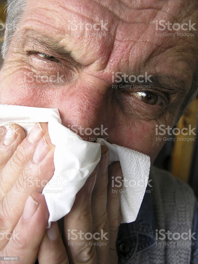 Man blowing his nose #2 royalty-free stock photo