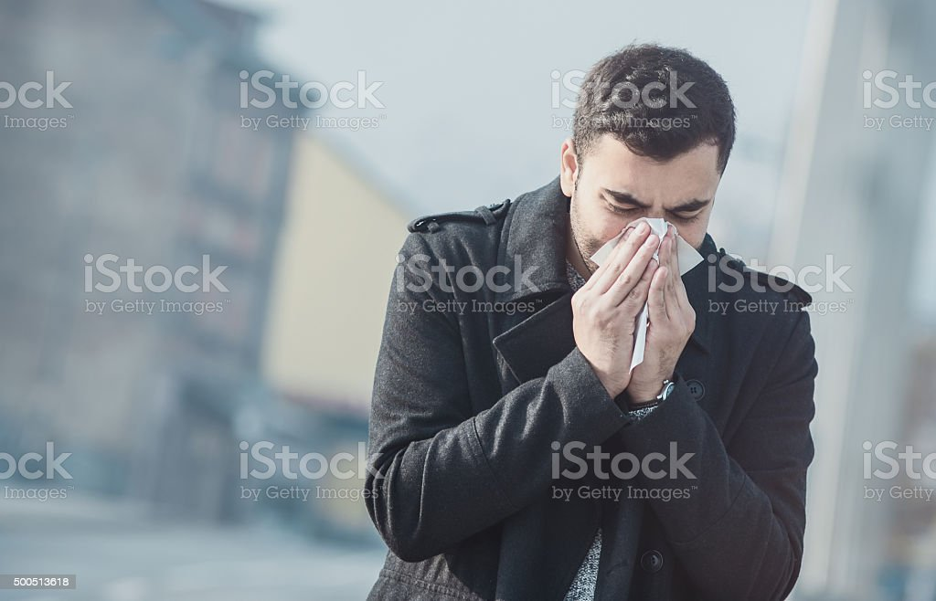 Man blowing nose stock photo