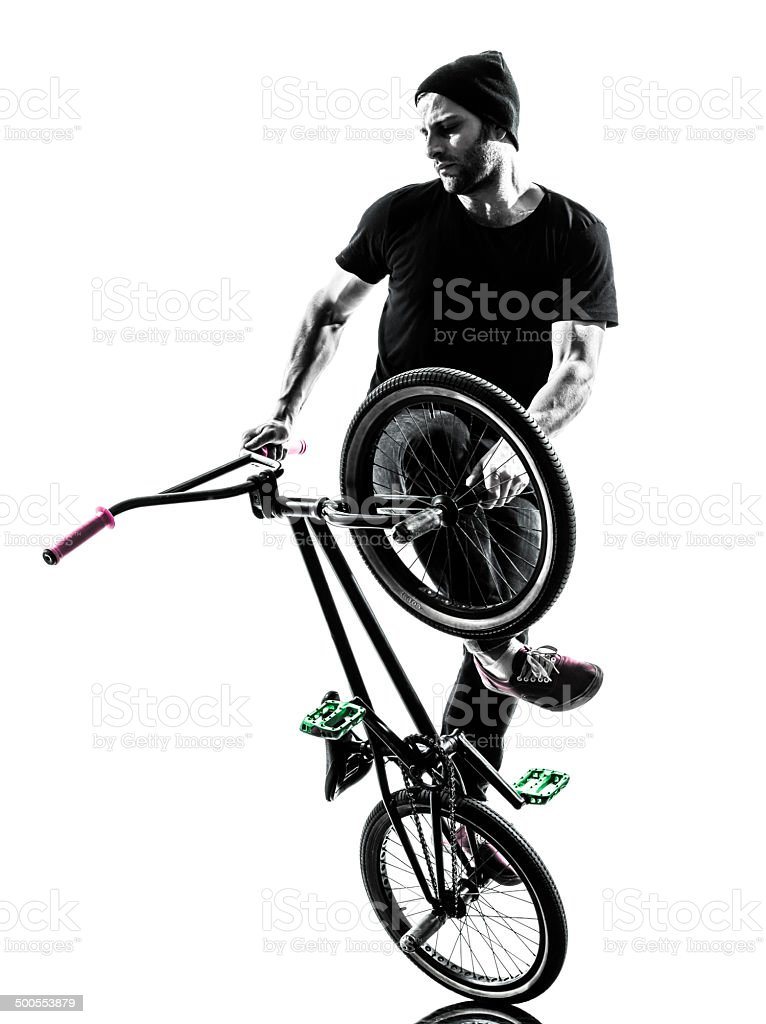 man bmx acrobatic figure silhouette stock photo