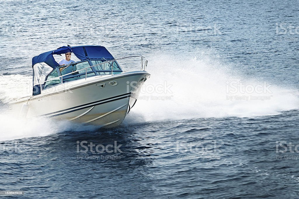 Man boating on lake stock photo
