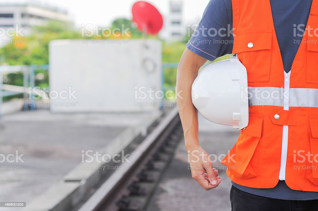 man body engineer hand holding white helmet for train stock photo