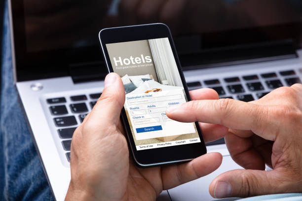 Man Booking Hotel Using Smartphone Close-up Of A Man's Hand Booking Hotel Using Smartphone making a reservation stock pictures, royalty-free photos & images