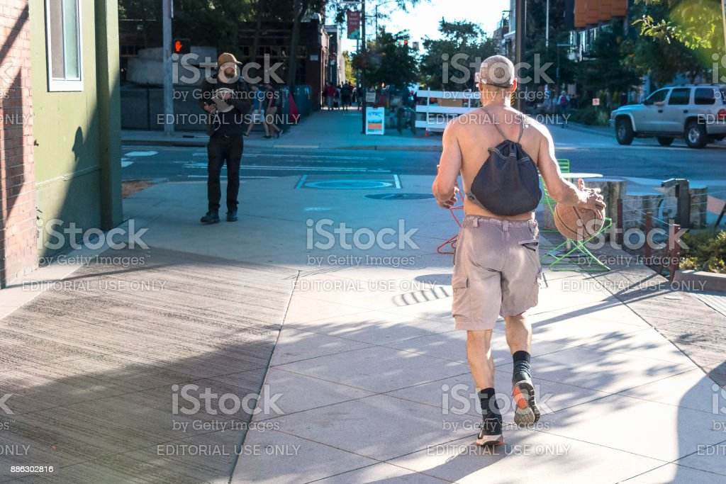 Man bouncing a ball stock photo