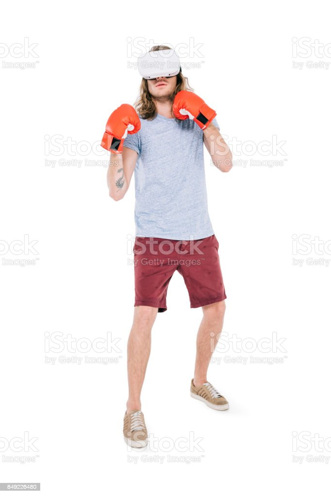 man boxing in virtual reality headset stock photo
