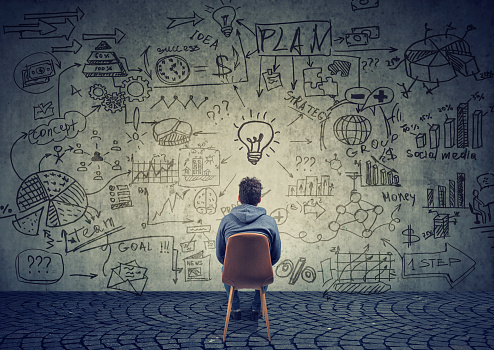 istock Man brainstorming on business plan 934271094