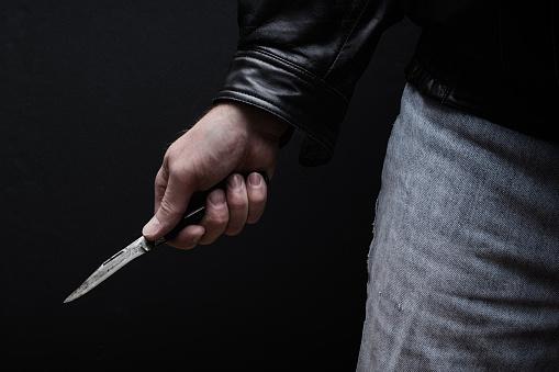 Man brandishing knife in a threatening manner.