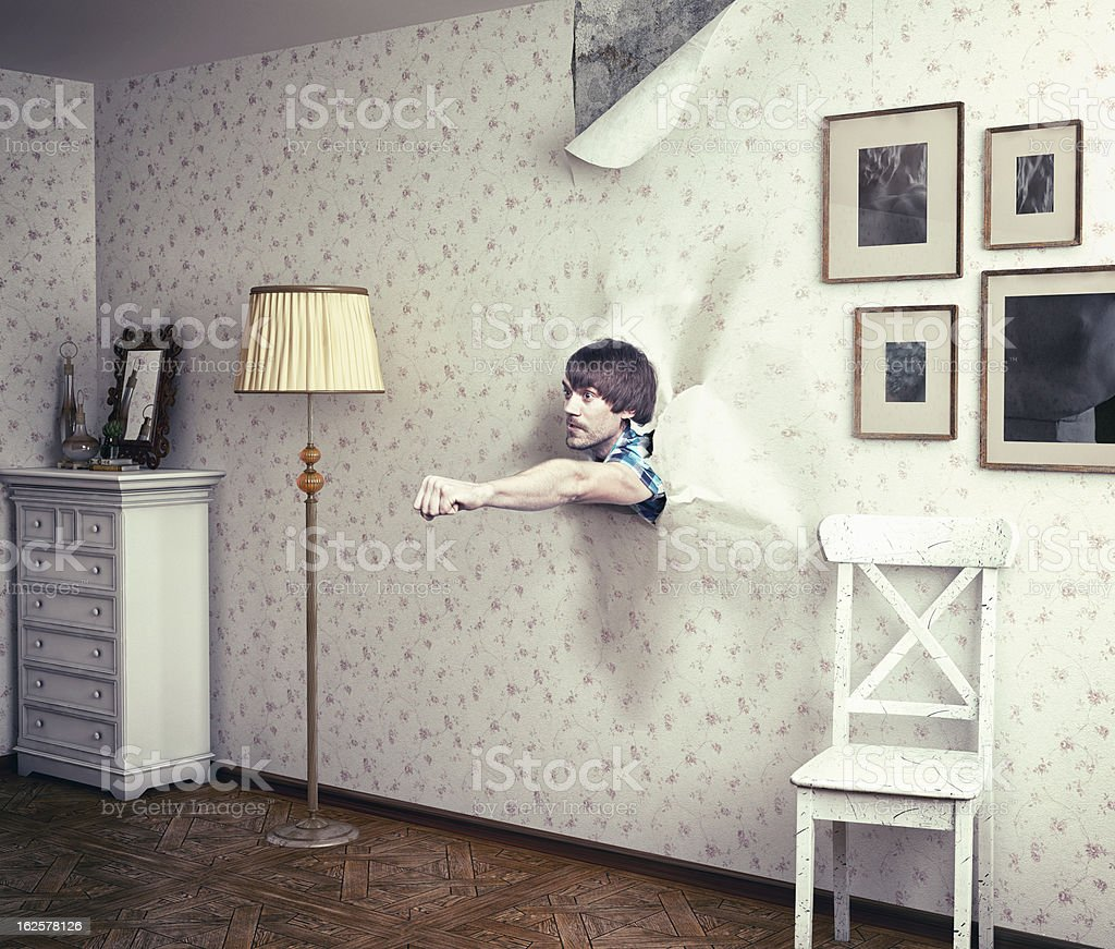 man break wall stock photo