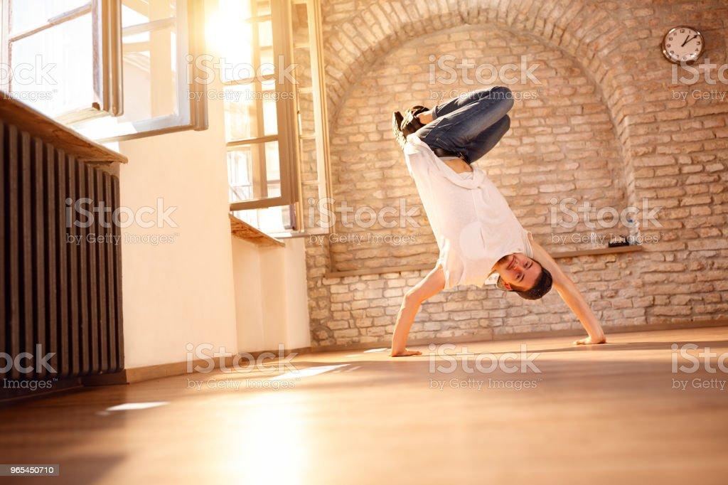 Man break-dancer doing handstand on hands royalty-free stock photo