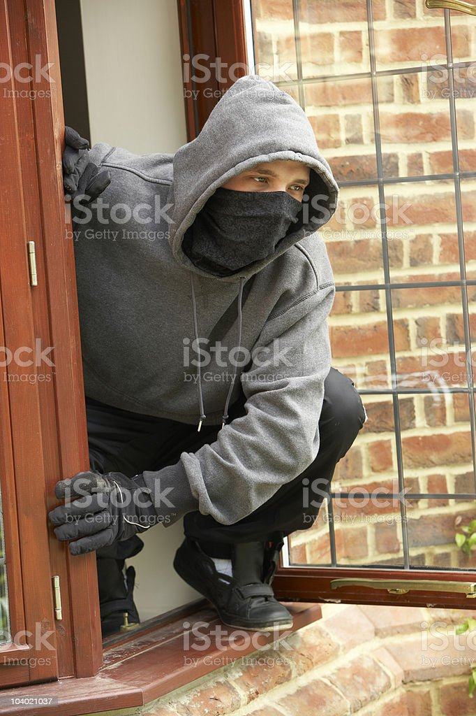 Man Breaking Into House royalty-free stock photo
