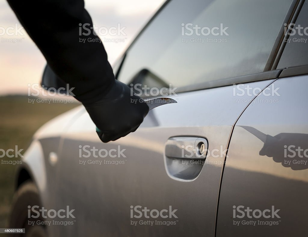 man breaking into the car royalty-free stock photo
