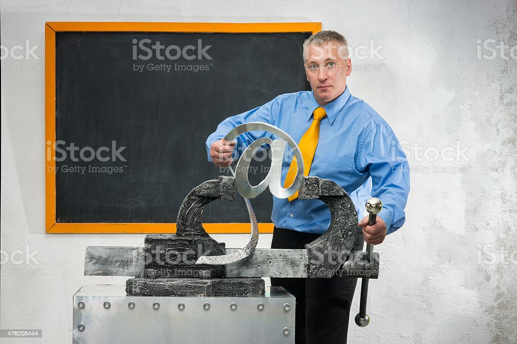 Man breaks sign of e-mail stock photo