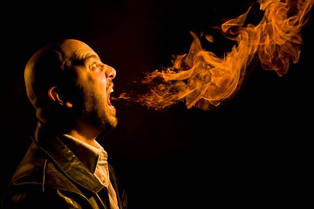 Man Breathing Fire - Heartburn, Bad Breath, or Anger stock photo