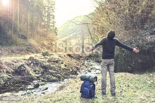 istock Man breathing in the forest under light 603164526