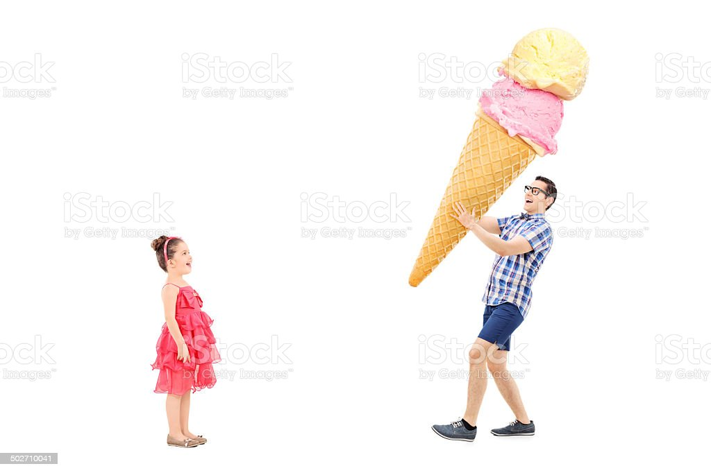 Man bringing huge ice cream to excited girl stock photo
