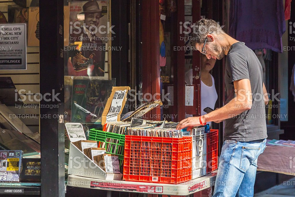 Man browses vinyl records at a Greenwich Village record store stock photo