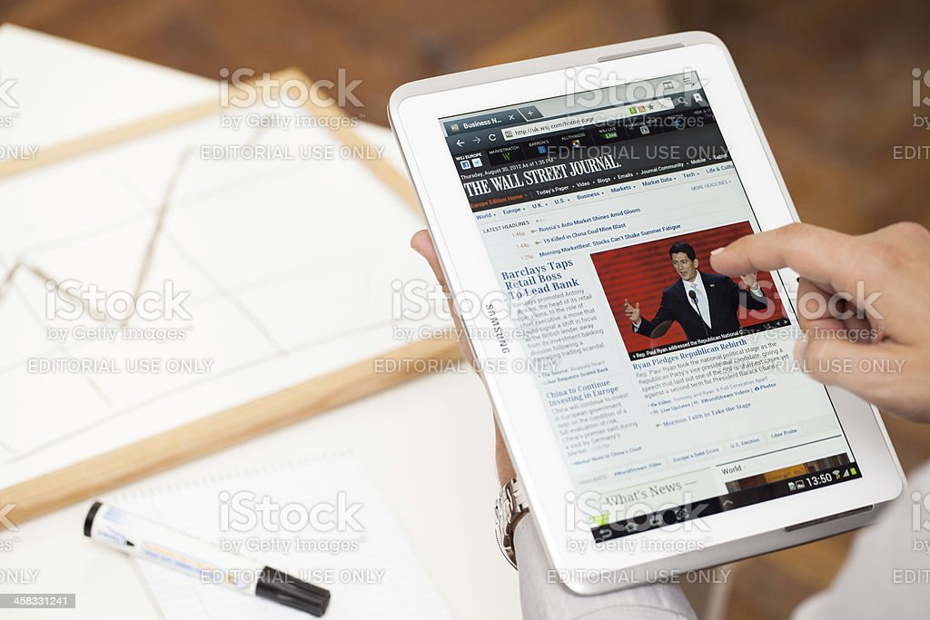 Man browsing on Samsung Galaxy Note 10.1' - N8000 stock photo