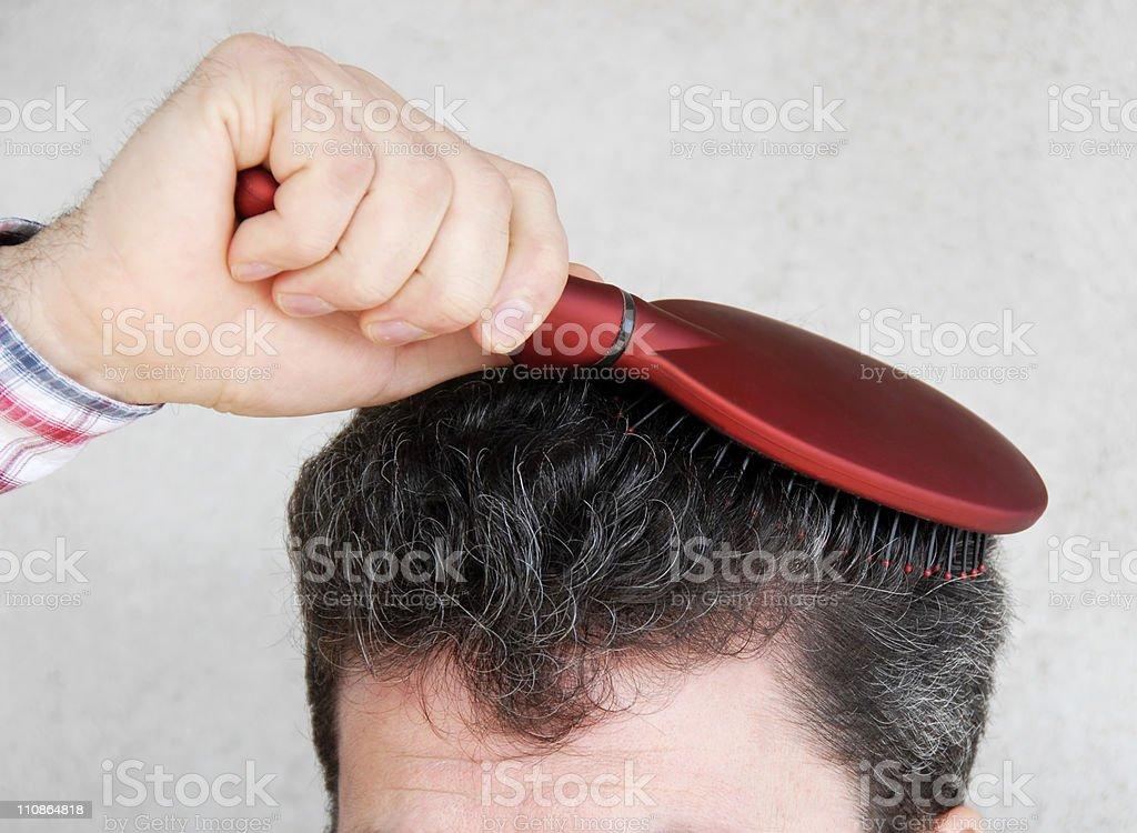Man brushing hair stock photo