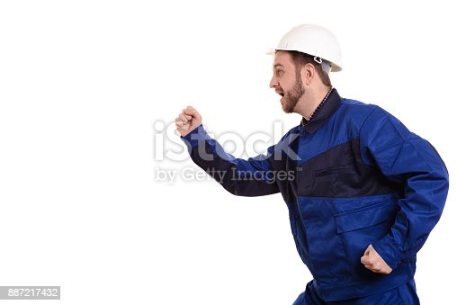 istock man builder in hard hat and overalls runs for construction isolated on the white background 887217432