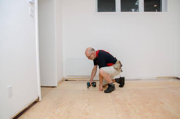 Man building a floor in home basement