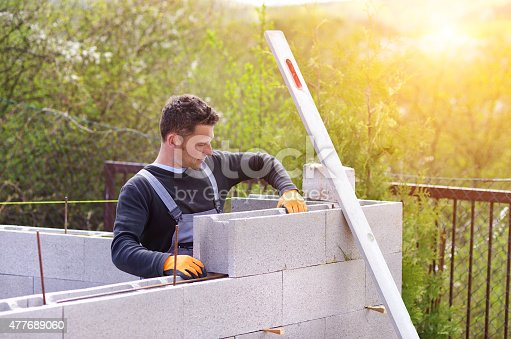 istock Man building a house 477689060