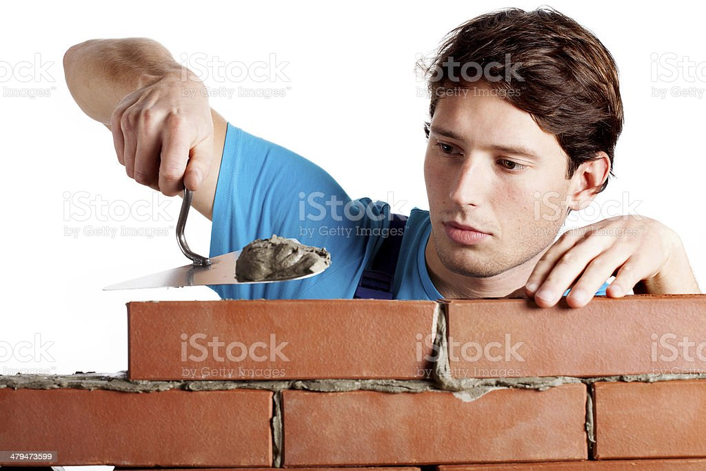 Man building a wall royalty-free stock photo