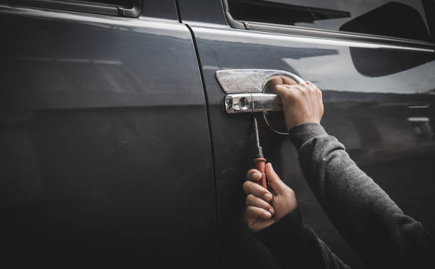 Man burglar stealing car Man burglar stealing car thief stock pictures, royalty-free photos & images