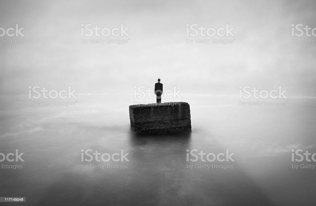 Man buried in a stone stock photo