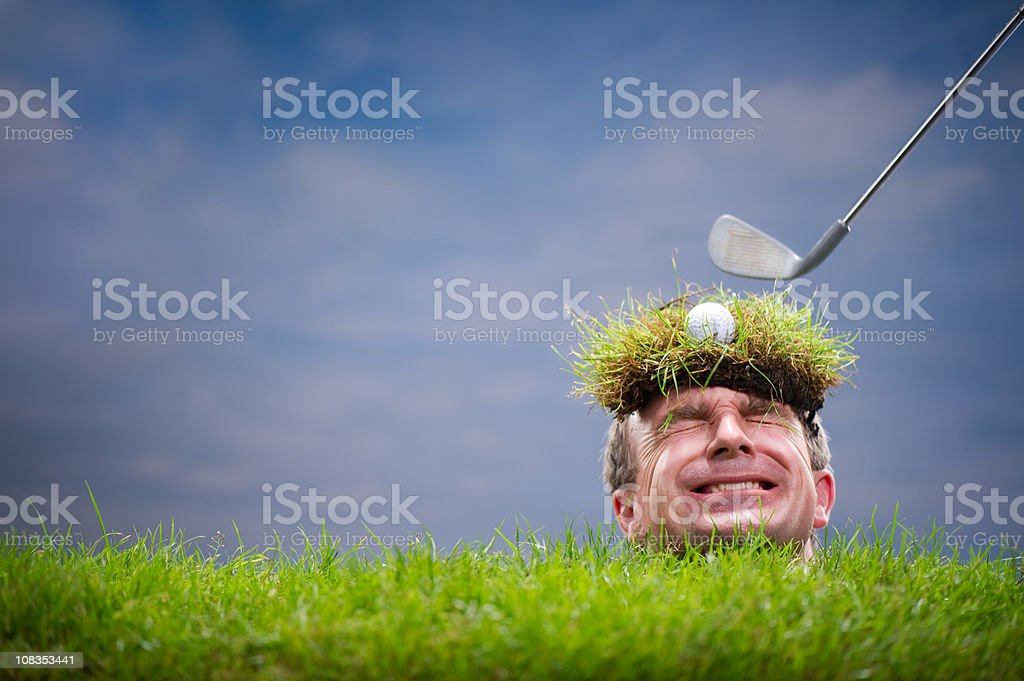 Man Buried on a Golf Course royalty-free stock photo