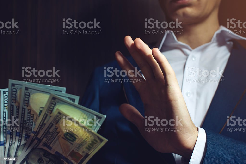 man businessman in suit refuses to take the bribe stock photo