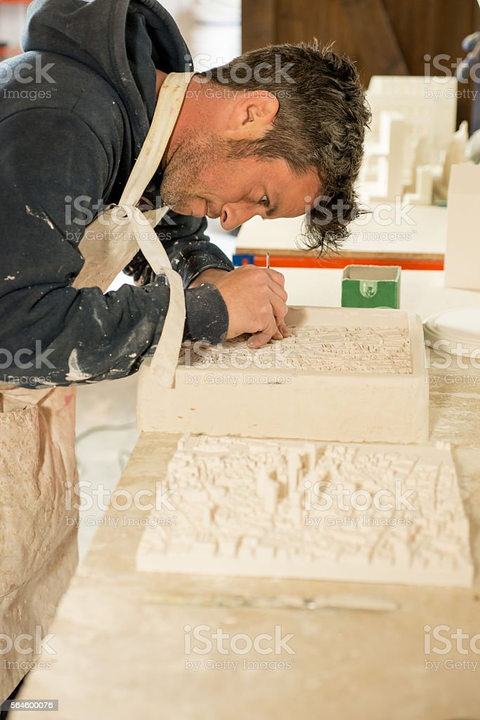 Man Busy Detailing a Plaster 3D Model City Map stock photo