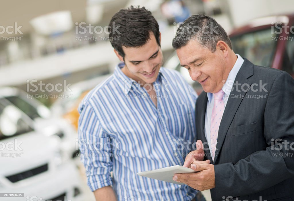 Man buying a car stock photo