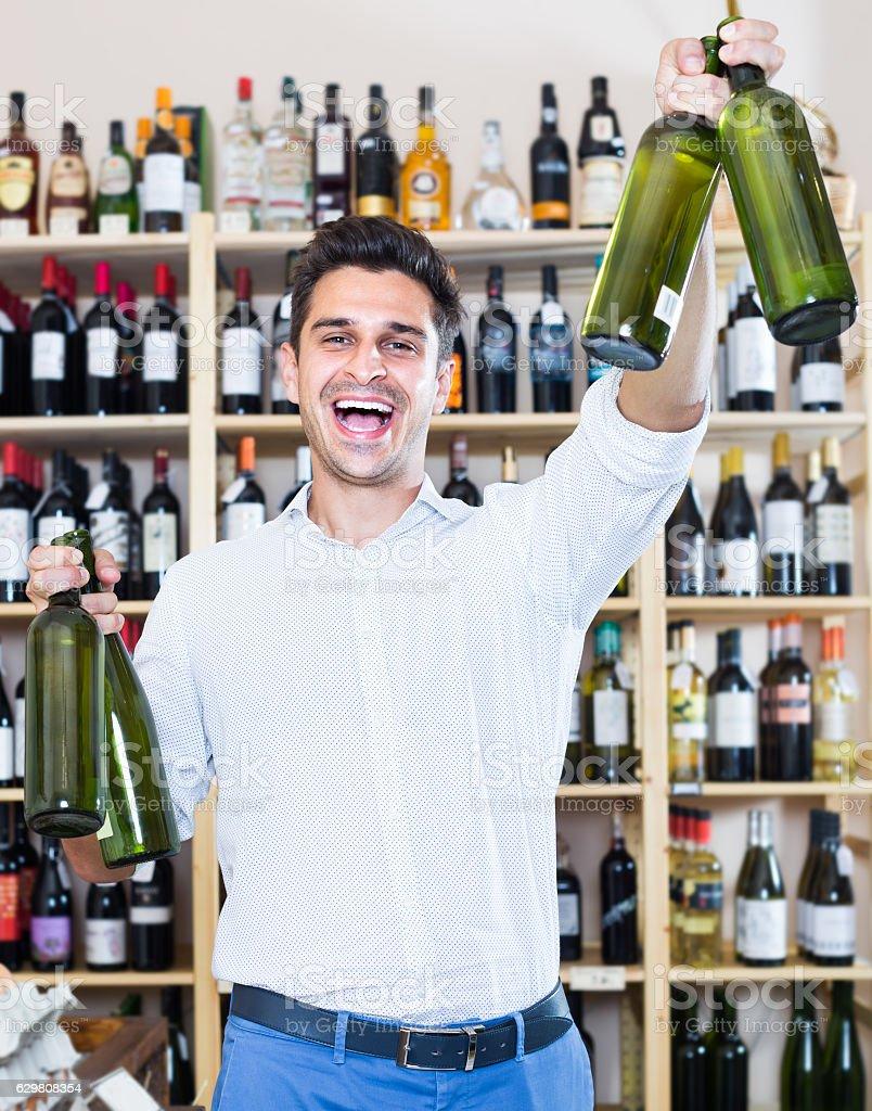 man buying bottle of wine stock photo