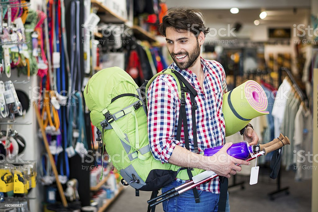 Man buying camping equipment stock photo