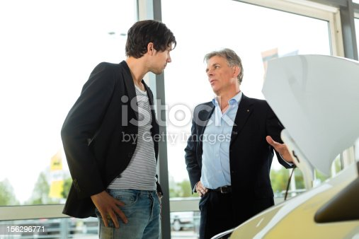 136591850 istock photo Man buying car from salesperson 156296771