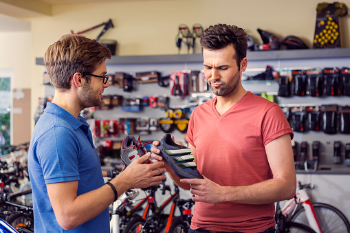 Man Buying Cycling Shoes Stock Photo - Download Image Now