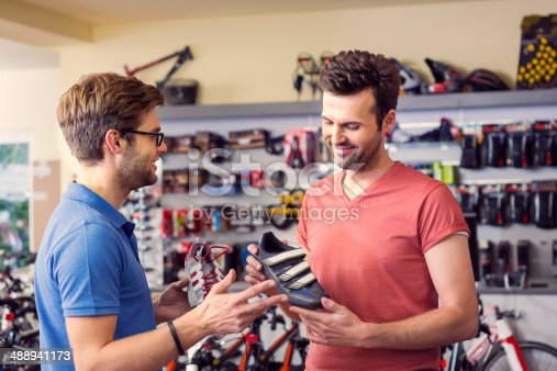 istock Man buying cycling shoes 488941173