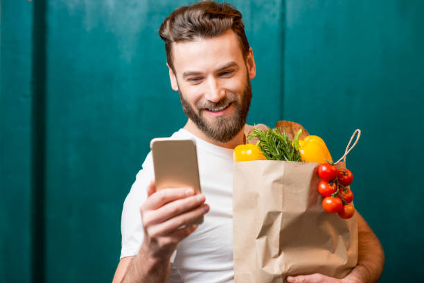 man buying food online - handytasche stock-fotos und bilder